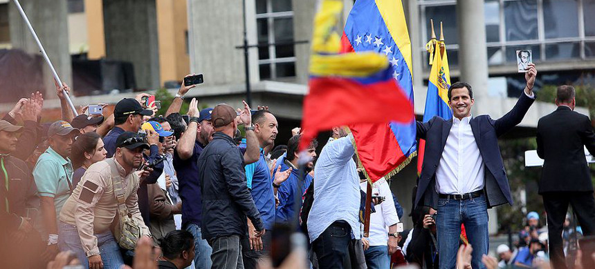 Venezuelan opposition leader Juan Guaidó declares himself interim president as thousands of people protest against Nicolás Maduro on January 23, 2019. (photo: Edilzon Gamez/Getty)