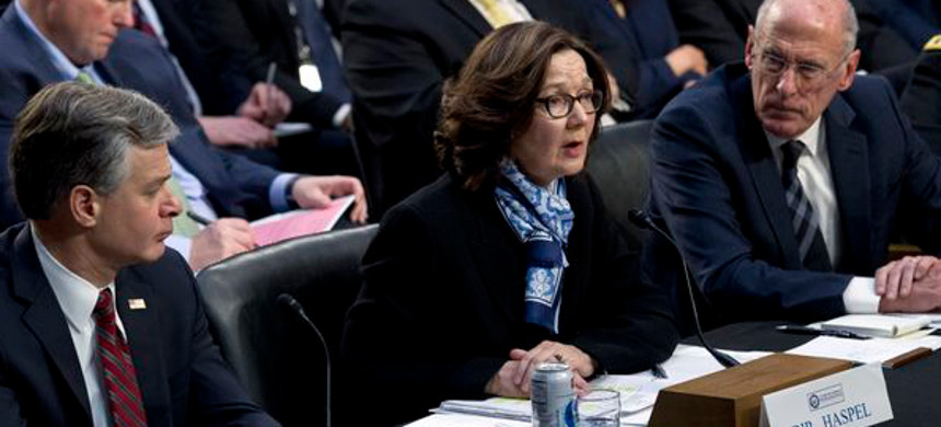 CIA director Gina Haspel accompanied by FBI director Christopher Wray and Director of National Intelligence Daniel Coats testifies before the Senate Intelligence Committee. (photo: Jose Luis Magana/AP)