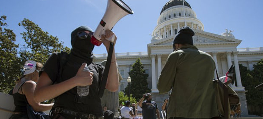Anti-fascist activists stage a counter-protest against the Traditionalist Worker party and the Golden State Skinheads at the State Capitol in Sacramento. (photo: Paul Kitagaki Jr/Shutterstock)