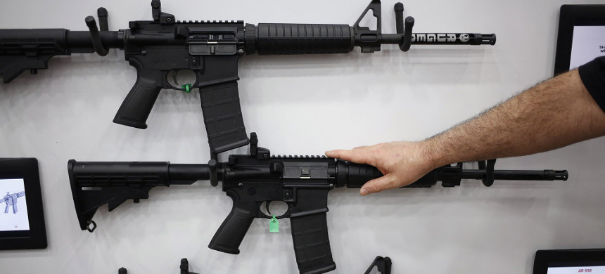 AR-15 rifles are displayed on the exhibit floor during the National Rifle Association (NRA) annual meeting in Louisville, Kentucky. (photo: Luke Sharrett/Getty)
