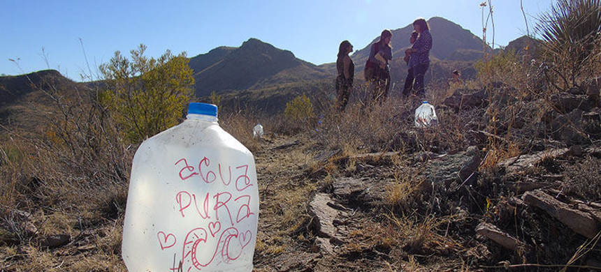Gallons of water on the path to the top of a mountain in Nogales, Arizona. (photo: Leah Goldberg/Cronkite News)