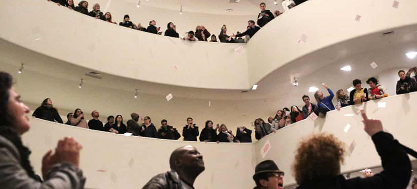 Photographer Nan Goldin leads an anti-opioid protest at the Guggenheim Museum in New York against its funding by the Sackler family. (photo: Yana Paskova/Guardian UK)