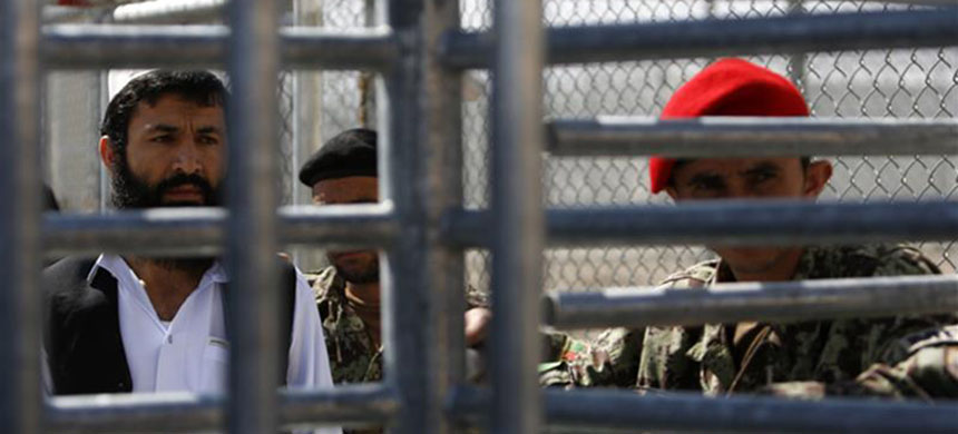 A prisoner stands in line for his release during a ceremony handing over the Bagram prison to Afghan authorities, at the US airbase in Bagram, north of Kabul March 25, 2013. (photo: Mohammad Ismail/Reuters)