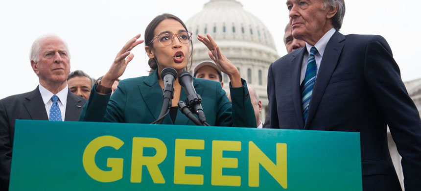 Representative Alexandria Ocasio-Cortez and Senator Ed Markey announce Green New Deal Legislation to Promote Clean Energy outside the U.S. Capitol. (photo: Saul Loeb/AFP/Getty Images)