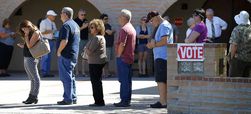 Voters line up to cast their ballots. (photo: AP)