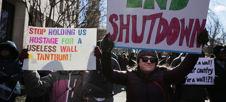 Hundreds of federal workers and contractors rally against the partial federal government shutdown outside the headquarters of the AFL-CIO on January 10, 2019, in Washington, D.C. (photo: Chip Somodevilla/Getty)