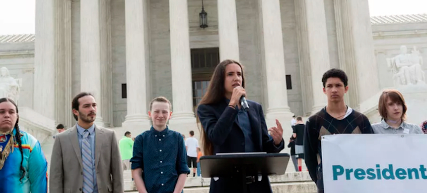 Earth Guardians Youth Director Xiuhtezcatl Martinez, one of the plaintiffs in the Juliana v. US climate lawsuit, speaks outside the U.S. Supreme Court in 2017. (photo: Robin Loznak/Our Children's Trust)