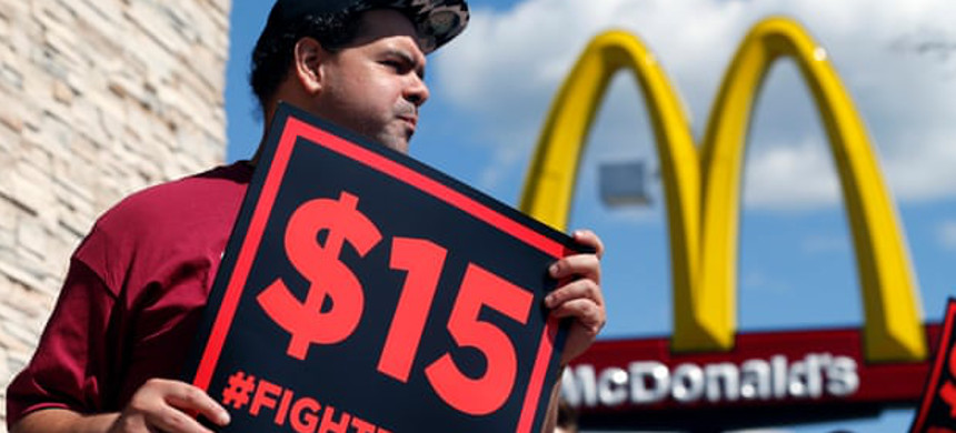 Fast-food restaurants in New York City may soon have to adhere to a law that prohibits firing an employee without just cause. (photo: Mike Groll/AP)