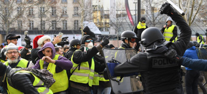 Riot police clash with Yellow Vest protesters. (photo: AFP)