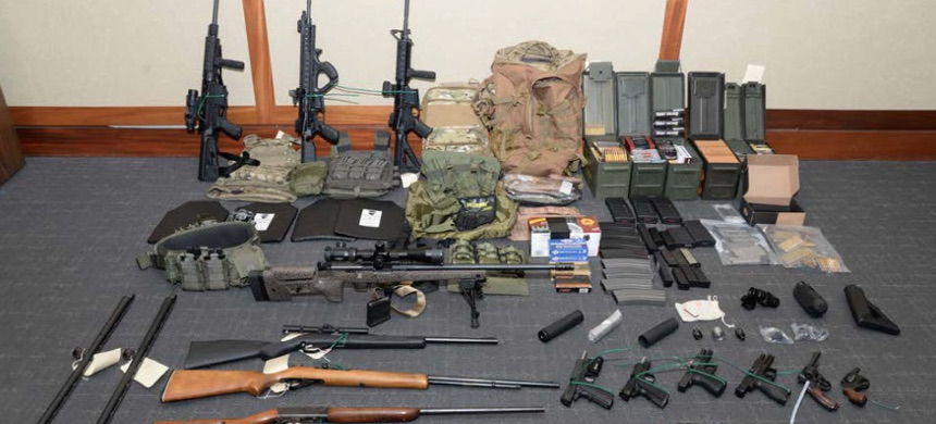The stockpile of guns found by investigators owned by Christopher Hasson. (photo: US Attorney's Office in Maryland)