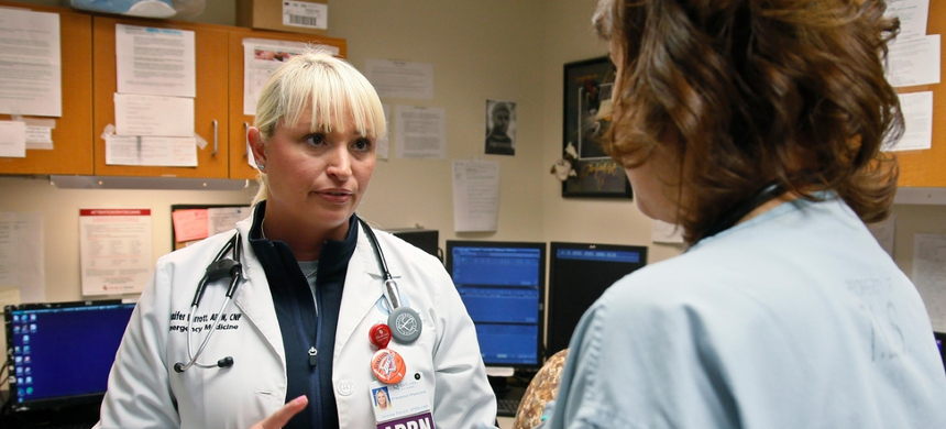 Jennifer Parrott, a certified nurse practitioner, left, talks with a doctor about a patient at the Oklahoma Health Sciences Emergency Department, in Oklahoma City. (photo: Sue Ogrocki/AP)