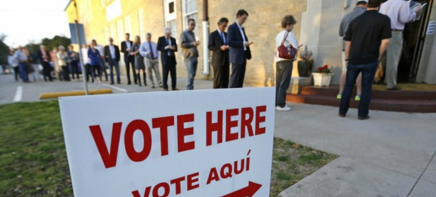 Voters wait in line to cast their ballots. (photo: Getty)