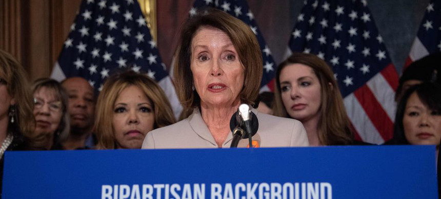 House Speaker Nancy Pelosi joins with lawmakers and activists to introduce a universal background checks bill. (photo: Nicholas Kamm/Getty)