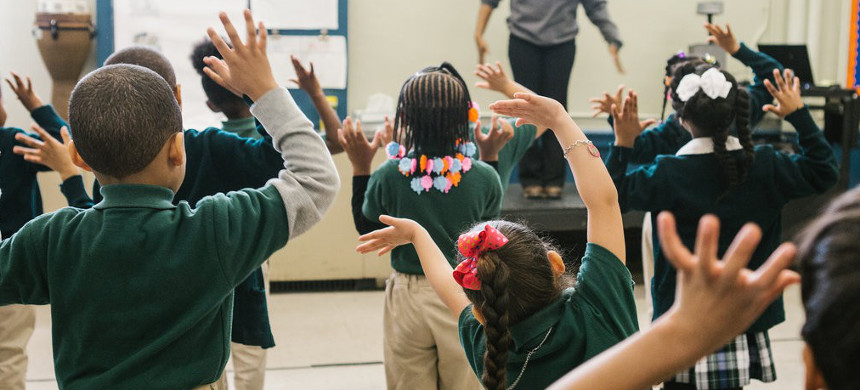 Kindergarten students dancing during a performance arts class at a school in New Jersey. (photo: Michelle Gustafson/The New York Times)