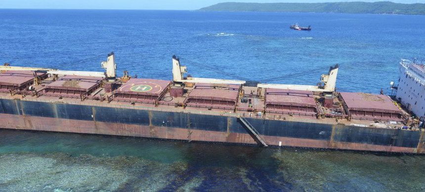 In this February 26, 2019, photo taken by the Australian Maritime Safety Authority near Rennell Island in the Solomon Islands shows the 'MV Solomon Trader' ship which ran aground February 5. (photo: The Australian High Commission Solomon Islands/AP)