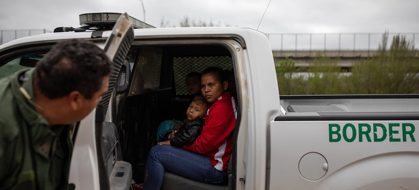Migrants from Honduras were taken into custody by Border Patrol agents near Granjeno, Texas, last month. (photo: Tamir Kalifa/NYT)