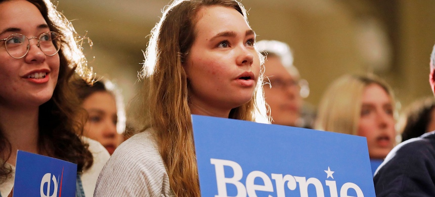 Audience members listen to 2020 Democratic presidential candidate Senator Bernie Sanders speak during a rally, Friday, March 8, 2019, at the University of Iowa in Iowa City, Iowa. (photo: Charlie Neibergall/AP)