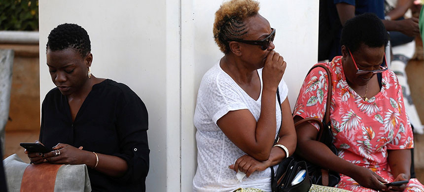 Relatives gathered at Nairobi airport waiting for details. (photo: Baz Ratner/Reuters)