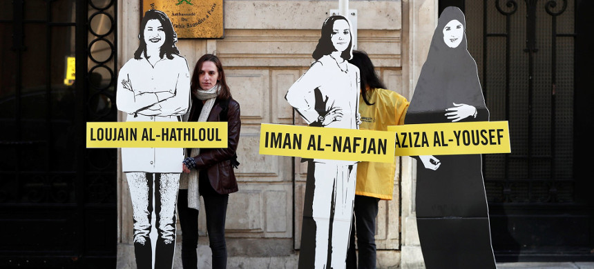 Demonstrators from Amnesty International call on Saudi authorities to release jailed women's rights activists Loujain al-Hathloul, Eman al-Nafjan and Aziza al-Yousef outside the Saudi Arabian Embassy in Paris, France, on March 8. (photo:Benoit Tessier/Reuters)