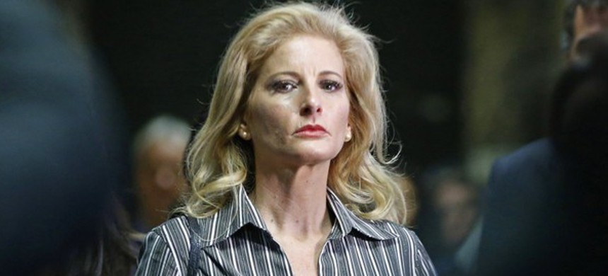 Summer Zervos leaves Manhattan Supreme Court at the conclusion of a hearing in New York on December 5, 2017. (photo: AP)