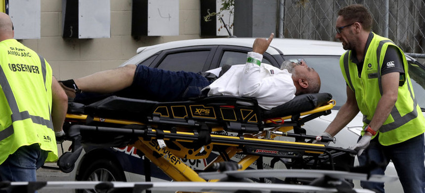 Ambulance staff take a man from outside a mosque in central Christchurch, New Zealand, on Friday. Multiple people are in custody after shootings at two mosques there. (photo: Mark Baker/AP)