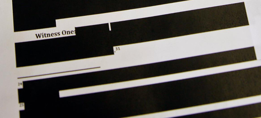 A document with redactions released under the Freedom of Information Act. (photo: Eric Risberg/AP)
