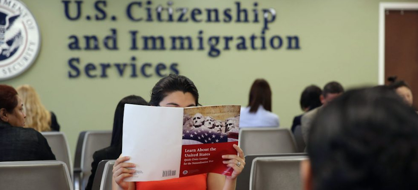 A Colombian immigrant studies ahead of her citizenship exam at a U.S. Citizenship and Immigration Services (USCIS) office. (photo: John Moore/Getty Images)