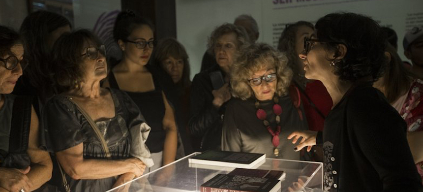 Curator Alejandra Dandan, right, speaks during the inauguration of the exhibit. (photo: Daniel Jayo/AP)