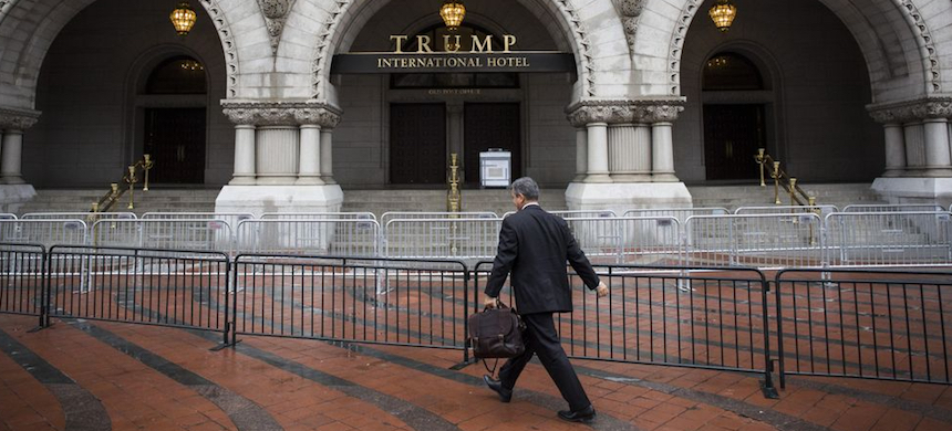 A pedestrian passes in front of the Trump International Hotel in Washington, D.C. (photo: Zach Gibson/Bloomberg)