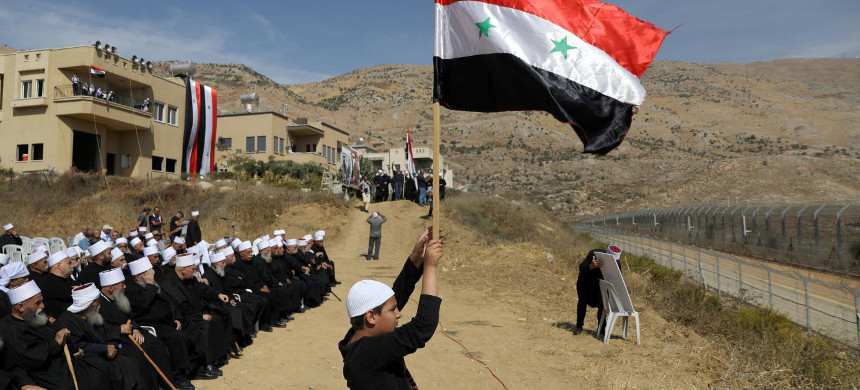 Syrians rally in Majdal Shams in Israeli-occupied Golan Heights last October. (photo: Reuters)