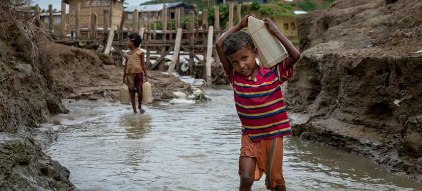 A 10-year-old boy from Myanmar collects water at a camp in Cox's Bazar, Bangladesh. Attacks on water and sanitation have become a feature of modern warfare. (photo: Patrick Brown/Unicef)