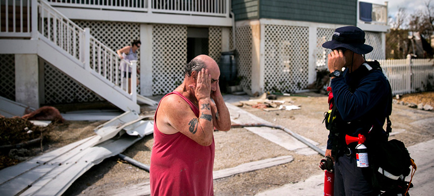 A resident of Big Pine Key, Fla., with a Federal Emergency Management Agency official after Hurricane Irma in 2017. FEMA unnecessarily shared sensitive personal data of perhaps 2.3 million disaster victims with a contractor, a government report said. (photo: Sam Hodgson/NYT)