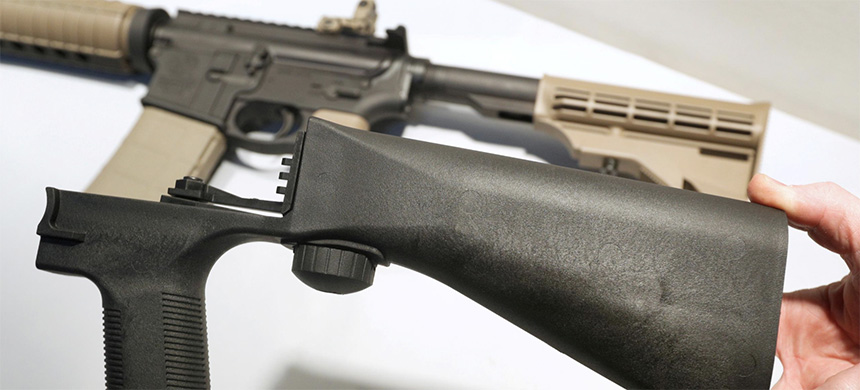A bump fire stock that attaches to a semi-automatic rifle to increase the firing rate is seen at Good Guys Gun Shop in Orem, Utah, U.S., October 4, 2017. (photo: George Frey/Reuters)