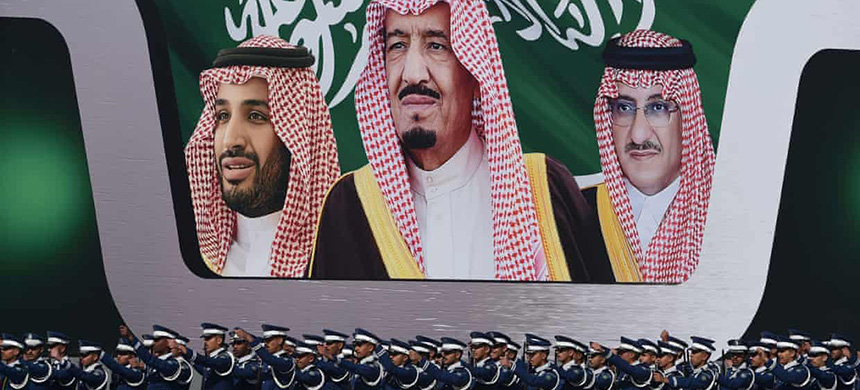 Newly graduated Saudi air force officers march in front of a banner bearing portraits of Crown Prince Mohammed bin Salman, his father King Salman, and Crown Prince Mohammed bin Nayef. (photo: Fayez Nureldine/AFP/Getty Images)