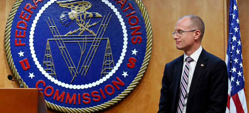 Federal Communications Commission (FCC) Commissioner Brendan Carr answers a question from the media after an FCC meeting to vote on net neutrality, December 14, 2017, in Washington. (photo: Jacquelyn Martin/AP)