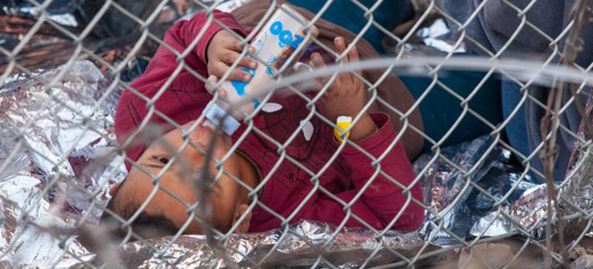 'US authorities have drawn criticism for holding groups of migrants awaiting processing - including children - underneath the Paso Del Norte Bridge in El Paso.' (photo: Getty Images)