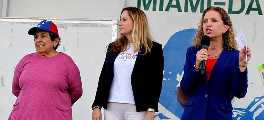 From left, Democratic Congresswomen Donna Shalala, Debbie Mucarsel-Powell and Debbie Wasserman Schultz joined many from the Venezuelan exile community at a protest in Doral Central Park in Doral, Florida, on Saturday, Feb. 2, 2019. (photo: Pedro Portal/Miami Herald)