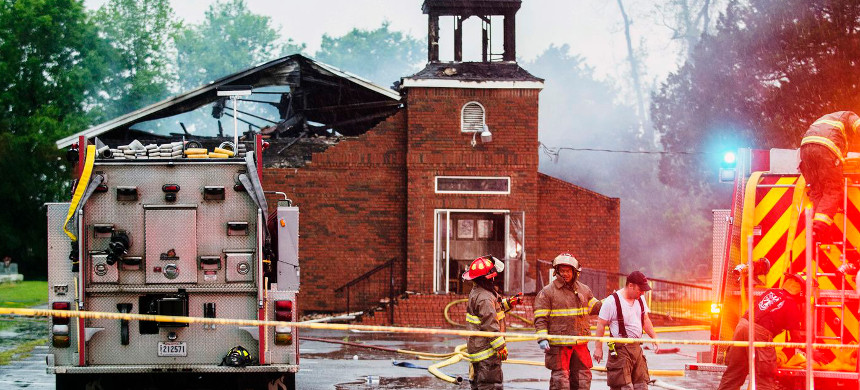 A 21-year-old man who is the son of a St. Landry Parish deputy was arrested on suspicion of committing arson at three black churches. (photo: Leslie Westbrook/AP)