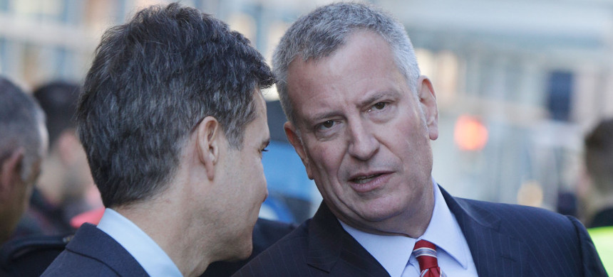 New York State senator Brad Hoylman (left) in a conversation with New York City mayor Bill de Blasio. (photo: Lars Niki/Getty)