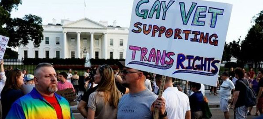 Demonstrators gather to protest U.S. president Donald Trump's announcement that he plans to reinstate a ban on transgender individuals serving in any capacity in the U.S. military. (photo: Reuters)