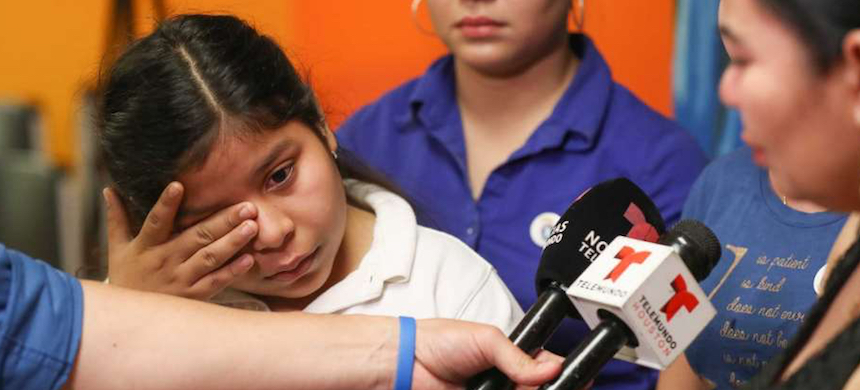 Laura Maradiaga, 11, becomes emotional as her family talk about her possible deportation back to El Salvador, Thursday, April 11, 2019, in Houston. (photo: Steve Gonzales/Chron)