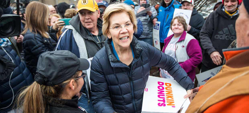 The Democratic presidential candidate Senator Elizabeth Warren greets striking Stop & Shop workers while also bringing coffee and donuts on Friday in Somerville, Massachusetts. (photo: Scott Eisen/Getty Images)