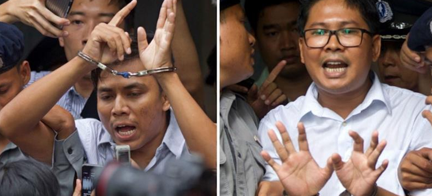 Kyaw Soe Oo, left, and Wa Lone are serving a seven-year sentence for violating Myanmar's colonial Official Secrets Act. (photo: Thein Zaw/AP)