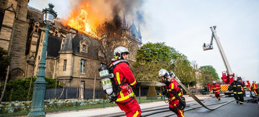 Firefighters battle the blaze at Notre Dame Cathedral in Paris, France. (photo: Benoit Moser/BSPP/Getty Images)