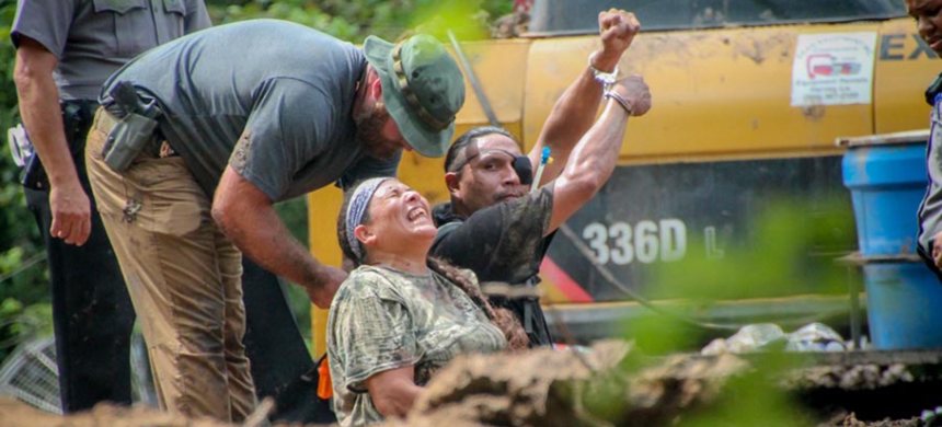 Sheriff's deputies arrest Cherri Foytlin (L) and another water protector opposing Louisiana's Bayou Bridge Pipeline near Bayou Chene on Sept. 4, 2018. Although invited onto the property by a landowner, the two were charged with felony trespassing under the state's new 'critical infrastructure' bill. (photo: Karen Savage)