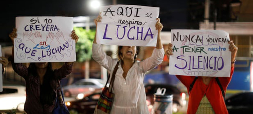 Women at a protest against femicide in San Salvador, on 29 March. (photo: Jose Cabesas/Reuters)