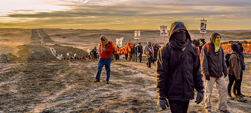 Water protectors walk a path carved out by the Dakota Access Pipeline on Standing Rock Sioux sacred ancestral grounds. (photo: Rob Wilson)