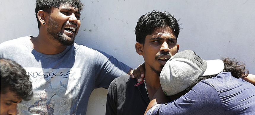 Relatives of people killed in Church blasts mourn as they wait outside mortuary of a hospital in Colombo, Sri Lanka, Sunday, April 21, 2019. Near simultaneous blasts rocked three churches and three hotels in Sri Lanka on Easter Sunday. (photo: Eranga Jayawardena/AP)