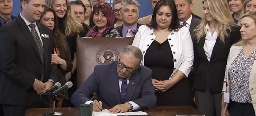 Governor Inslee of Washington signs law expanding statute of limitations for sexual assault prosecutions. (photo: KIRO7)