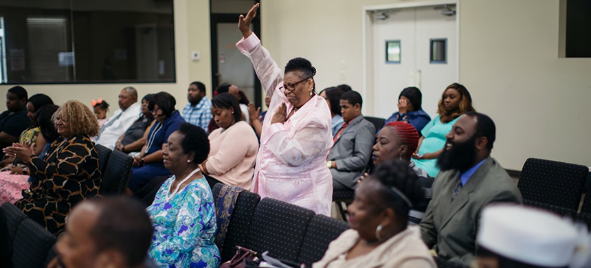 Ethel Thomas, 67, who has been a member of Mt. Pleasant Baptist Church for nearly 40 years, prays at Easter Sunday Church service at Equine Sales Company on April 21 in Opelousas, La. (photo: Annie Flanagan/WP)